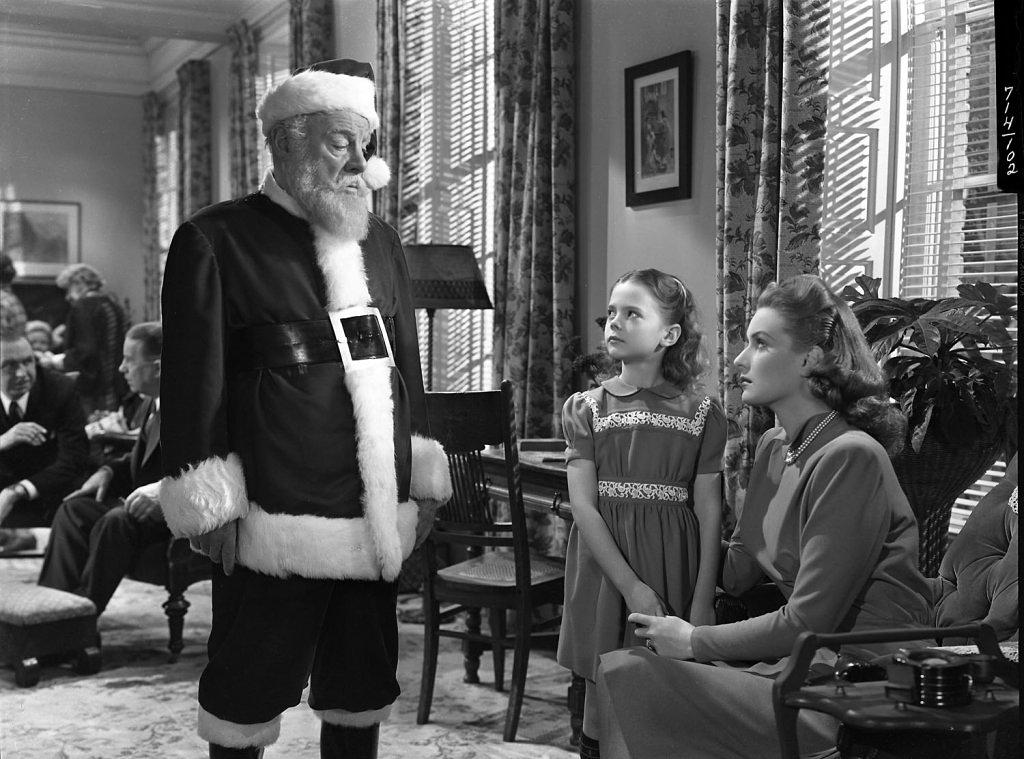 Edmund Gwenn, Natalie Wood, and Maureen O'Hara in a scene from MIRACLE ON 34TH STREET, 1947.