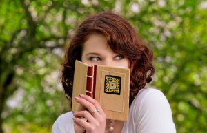 woman_hiding_behind_book